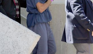 """Seen here in April 2007, """"Girls Gone Wild"""" creator Joe Francis uses papers to hide his face as he leaves the U.S. District Courthouse in Panama City, Fla. Francis is facing new legal jeopardy. (Associated Press)"""