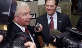 Former House Majority Leader Tom DeLay, right, and his attorney, Dick DeGuerin, left, answer questions from members of the media as they arrive at the Travis County courthouse in Austin, Texas on Tuesday, Oct. 26, 2010 for jury selection in his corruption trial. The 63-year-old Mr. DeLay is charged with money laundering and conspiracy to commit money laundering. (AP Photo/Jack Plunkett)