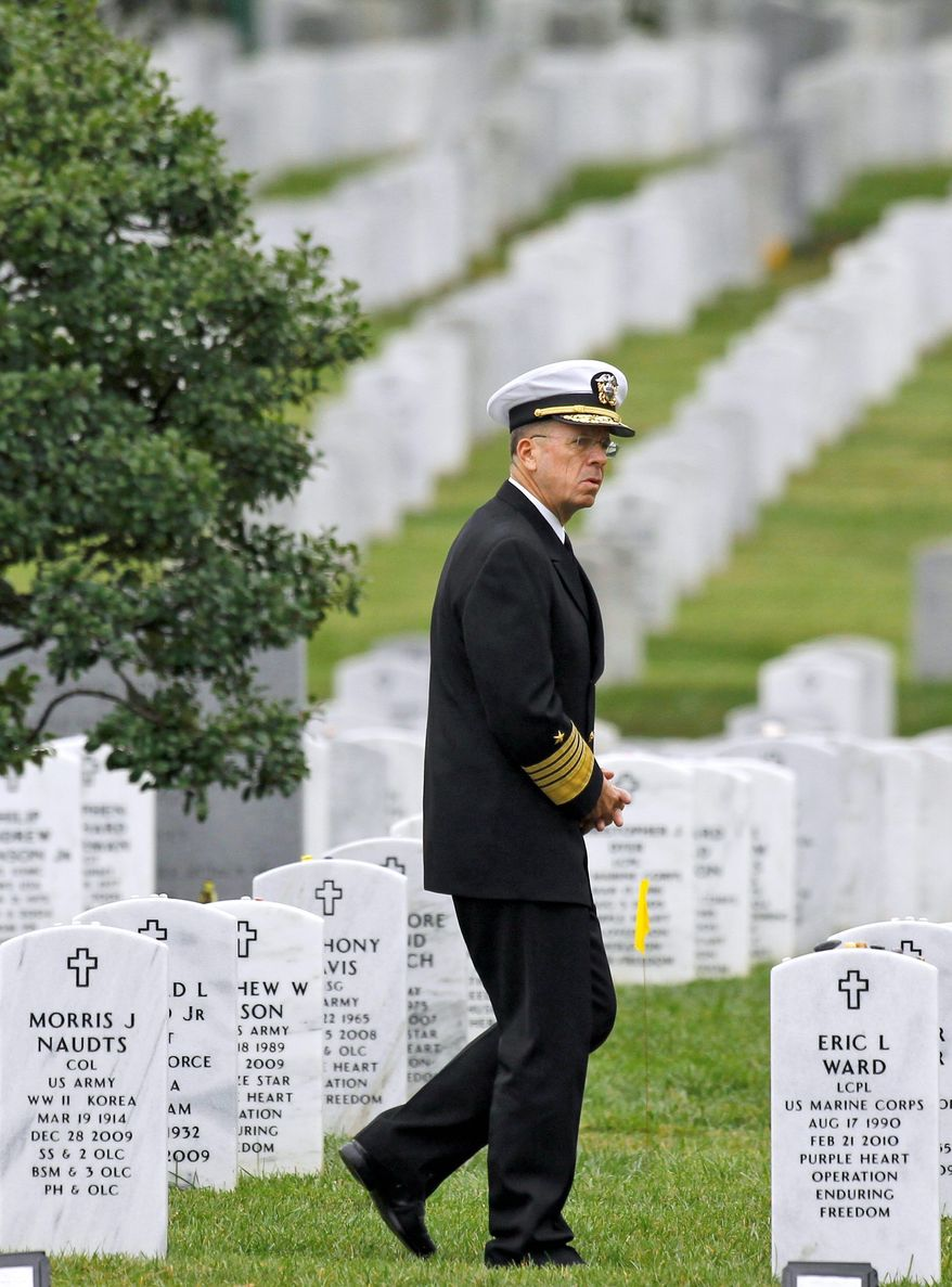 Adm. Mike Mullen, chairman of the Joint Chiefs of Staff, walks through Section 60 at Arlington National Cemetery in Arlington, Va., earlier this month. He is focusing on the problem of military suicides. (Associated Press)