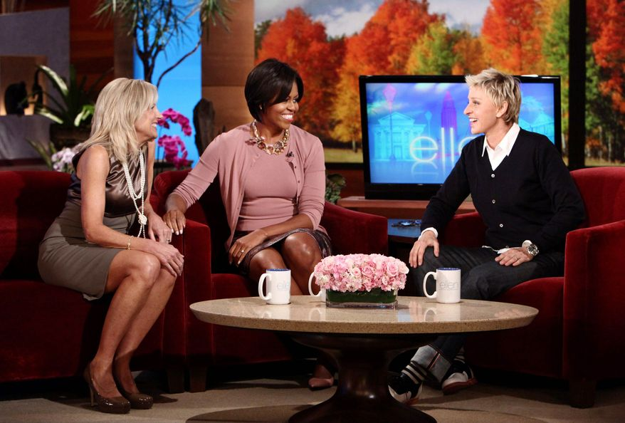 "DYNAMIC DUO: Michelle Obama and Jill Biden (left) bring political star power to ""The Ellen DeGeneres Show"" during taping Tuesday. The first lady and the vice president's wife are appealing to Democratic voting blocs as Election Day nears. (Associated Press)"