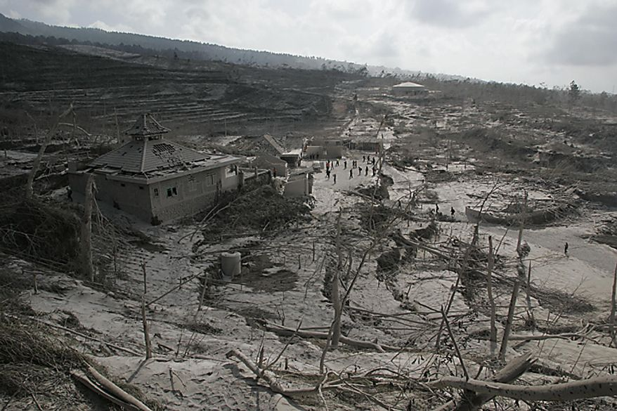 """A village that was hit by pyroclastic flows from Mount Merapi eruption is pictured in Kinahrejo, Yogyakarta, Indonesia, Wednesday, Oct. 27, 2010. A volcanic eruption and a tsunami killed scores of people hundreds of miles apart in Indonesia, spasms from the Pacific """"Ring of Fire,"""" which spawns disasters from deep within the Earth. (AP Photo/Trisnadi)"""