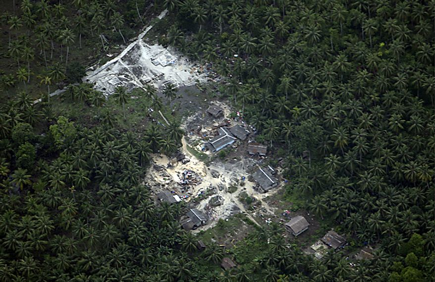 This aerial photo shows a village flattened by Monday's earthquake triggered tsunami on Pagai island, West Sumatra, Indonesia, Wednesday, Oct. 27, 2010. Planes and helicopters packed with rescue workers and supplies landed for the first time Wednesday on remote Indonesian islands that were pounded by a 10-foot (three-meter) tsunami, sweeping away villages and killing at least 154 people. (AP Photo/Achmad Ibrahim)
