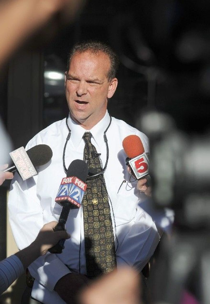 Sgt. Robert Bruchsaler of the Mid-Missouri Major Case Squad speaks outside the Callaway County Sheriff's Department in Fulton. Three people are dead and another is wounded after shootings in the county. (Associated Press)