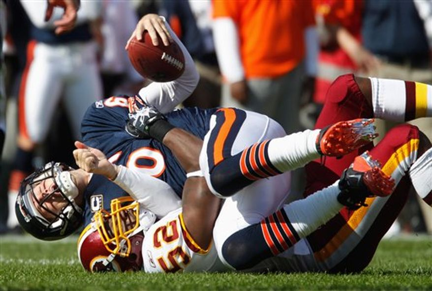 Chicago Bears quarterback Jay Cutler (6) is sacked by Washington Redskins linebacker Rocky McIntosh (52) in the first half of an NFL football game in Chicago, Sunday, Oct. 24, 2010. (AP Photo/Nam Y. Huh)