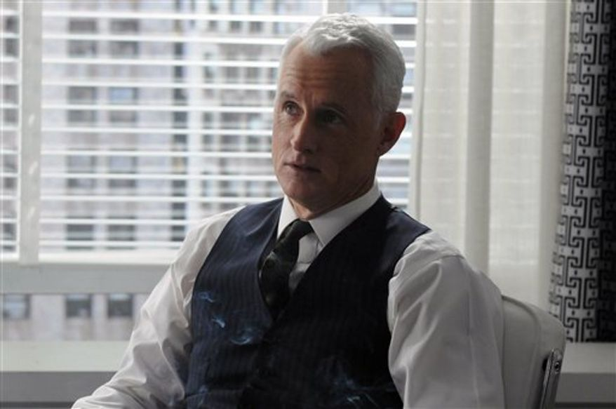"""In this publicity image released by AMC, John Slattery portrays ad executive Roger Sterling Jr.in a scene from """"Mad Men."""" (AP Photo/AMC)"""