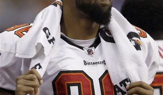 In this Sept. 2, 2010, photo, Tampa Bay Buccaneers tight end Jerramy Stevens stands on the sideline during an NFL preseason football game against the Houston Texans in Houston. Stevens sat out Sunday's game against St. Louis after police said he was arrested and charged with possessing marijuana. (AP Photo/David J. Phillip)