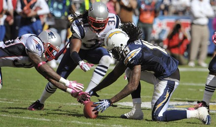 San Diego Chargers wide receiver Richard Goodman, right, drops the ball as New England Patriots safety Brandon Meriweather, center, and safety James Sanders, left, dive for it in the second half during an NFL football game Sunday, Oct. 24, 2010, in San Diego. Sanders recovered the ball. (AP Photo/Denis Poroy)