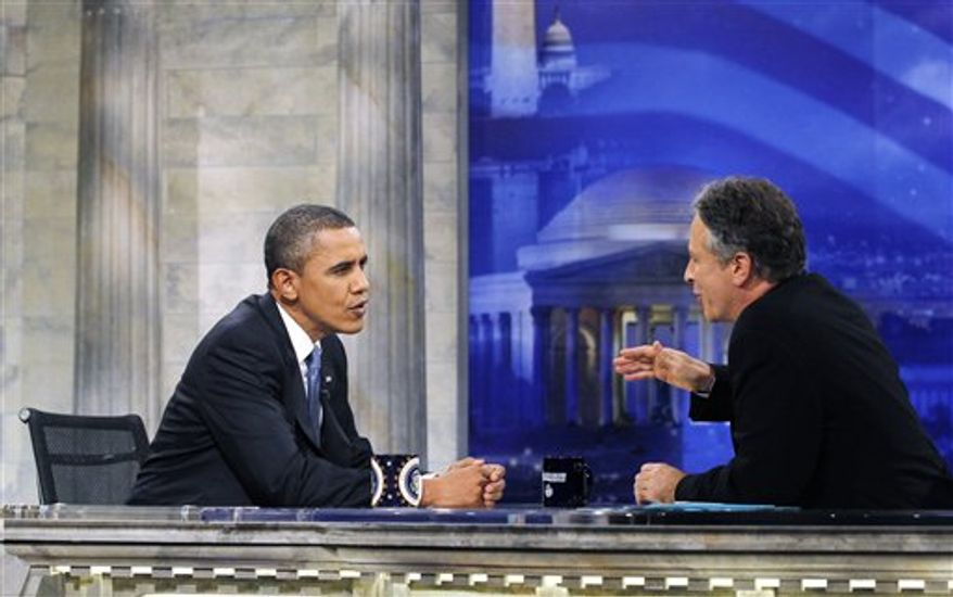 """President Barack Obama is pictured during a commercial break as he talks with host Jon Stewart as he takes part in a taping of Comedy Central's """"The Daily Show,"""" Wednesday, Oct. 27, 2010, in Washington. (AP Photo/Charles Dharapak) ** FILE **"""
