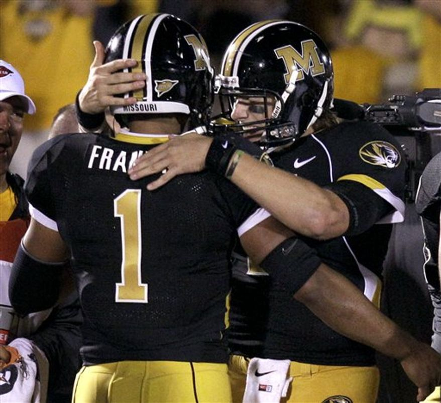 Missouri quarterback Blaine Gabbert, right, congratulates teammate James Franklin after Frankin's 3-yard touchdown run during the fourth quarter of an NCAA college football game against Oklahoma Saturday, Oct. 23, 2010, in Columbia, Mo. Missouri won 36-27. (AP Photo/Jeff Roberson)