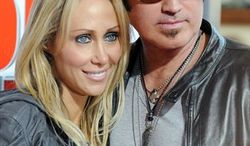 """FILE - In this April 23, 2009 file photo, singer and actress Miley Cyrus, left and her father musician Billy Ray Cyrus,  arrive for the British Premiere of the film '""""Hannah Montana"""",  at a Leicester Square cinema, in London.  (AP Photo/Joel Ryan, file)"""