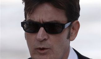 FILE - In this Feb. 8, 2010 file photo, Charlie Sheen arrives at the Pitkin County Courthouse in Aspen, Colo. (AP Photo/David Zalubowski, File)
