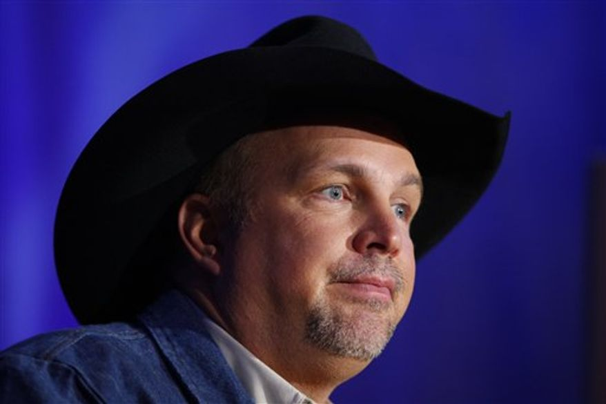 FILE - In this Jan. 25, 2008 file photo, country singer Garth Brooks performs during a charity concert in Los Angeles, to benefit the Southern California 2008 Fire Intervention Relief Effort (F.I.R.E). Brooks is going to be very busy in December. Brooks sold more than 140,000 tickets Saturday morning, Nov. 6, 2010, and his benefit concert for Nashville, Tenn., flood relief ballooned from one show to nine. (AP Photo/Mark J. Terrill, File)
