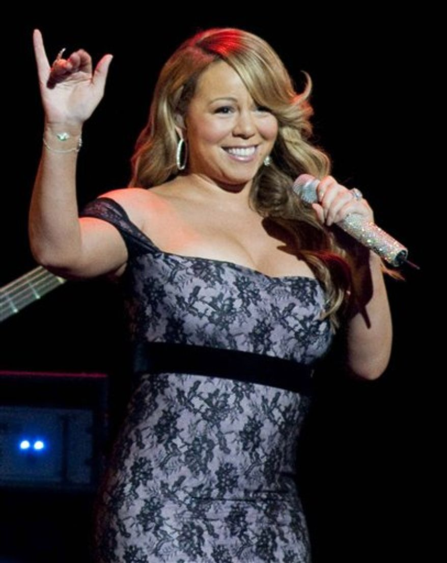 FILE - In this June 4, 2010 file photo, Grammy Award winning singer Mariah Carey performs during the Wal-Mart Stores Inc. shareholders' meeting in Fayetteville, Ark. (AP Photo/April L. Brown, File)
