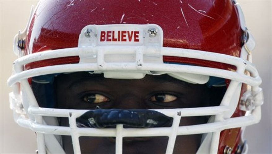 "A Rutgers football player has a sticker with ""Believe"" on the front of his helmet during an NCAA college football game against Pittsburgh, Saturday, Oct. 23, 2010 in Pittsburgh. The team placed the word there in support of teammate Eric LeGrande who suffered a spinal chord injury in a game last week against Army. Pittsburgh won 41-21.(AP Photo/Keith Srakocic)"