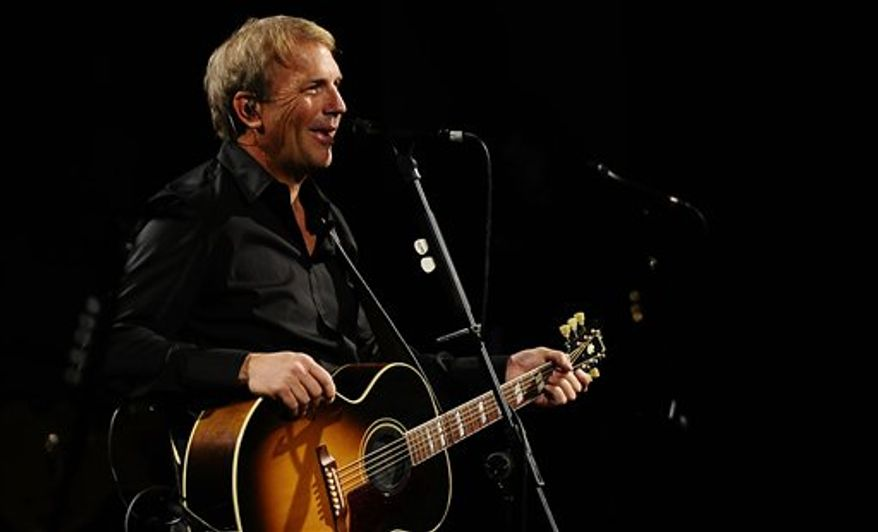 """FILE - In this Feb. 18, 2010 file photo, Kevin Costner performs in Barcelona, Spain. Costner will host CMT's new celebration of country music's artists of the year. """"CMT Artists of the Year"""" will air Dec. 3. The 90-minute show will honor Jason Aldean, Lady Antebellum, Taylor Swift, Carrie Underwood and the Zac Brown Band. (AP Photo/Manu Fernandez, File)"""