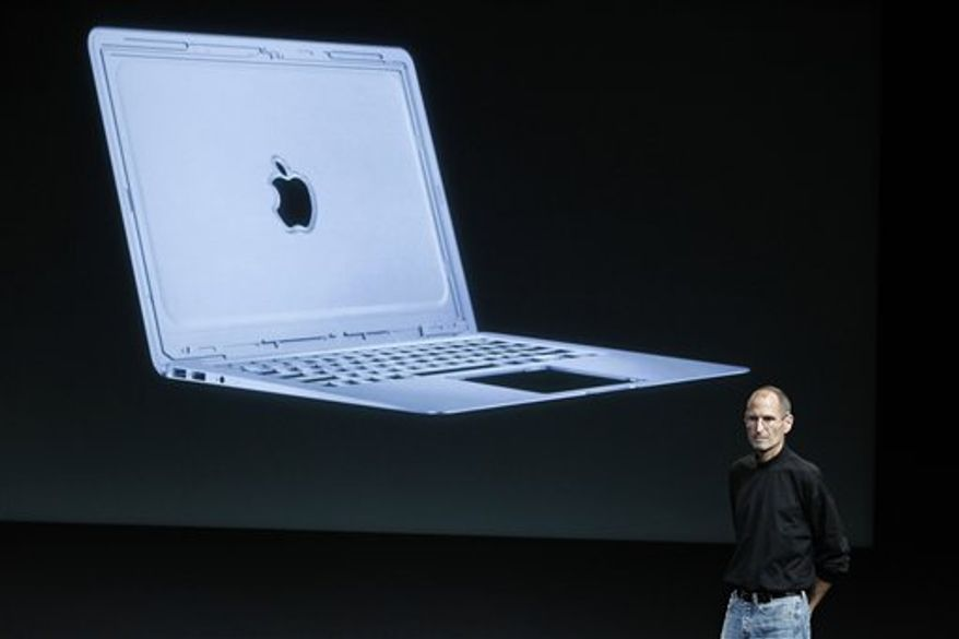 FILE - In this Oct. 20, 2010 file photo, Apple CEO Steve Jobs talks about the new Apple Macbook Air laptop at Apple headquarters in Cupertino, Calif. (AP Photo/Tony Avelar, file)