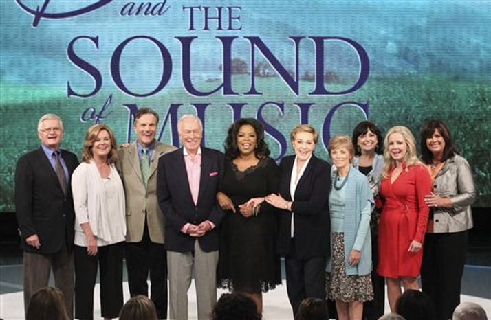 "This photo taken Sept. 23, 2010 and provided by Harpo Productions Inc., shows members of the cast of ""The Sound of Music"" reuniting for the first time in 45 years during taping of ""The Oprah Winfrey Show"" at Harpo Studios in Chicago. Pictured from left are: Duane Chase ""Kurt"", Heather Menzies-Urich ""Louisa"", Nicholas Hammond ""Friedrich"", Christopher Plummer, Oprah Winfrey, Julie Andrews, Charmian Carr ""Liesl,"" Angela Cartwright ""Brigitta"", Kym Karath ""Gretl"", and Debbie Turner ""Marta.""  The show will nationally on Thursday, Oct. 28, 2010. (AP Photo/Harpo Productions Inc., George Burns)"