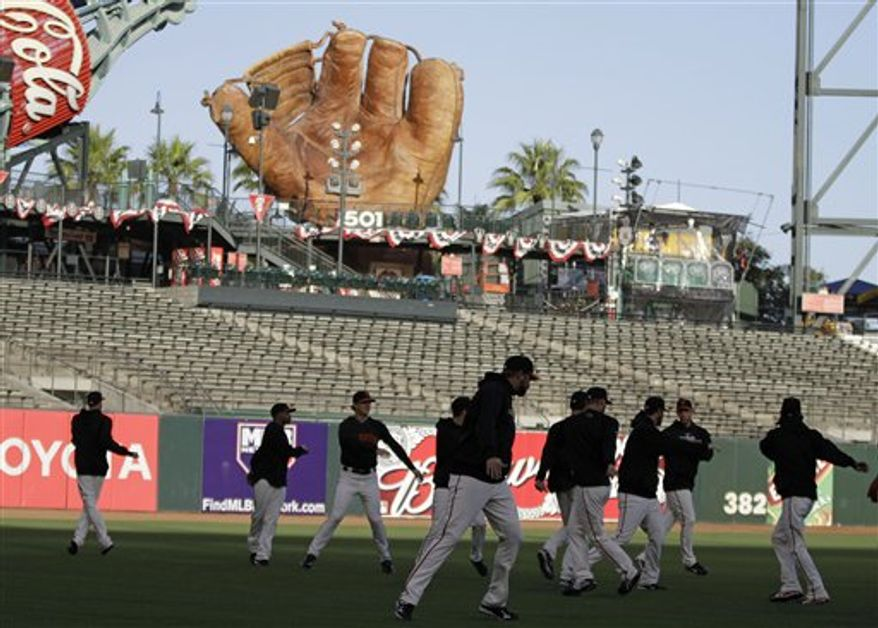 The San Francisco Giants take part in a running exercise in left field during a baseball workout at AT&T Park in San Francisco, Monday, Oct. 25, 2010. The Giants and the Texas Rangers are scheduled to play Game 1 of the World Series on Wednesday. (AP Photo/Eric Risberg)