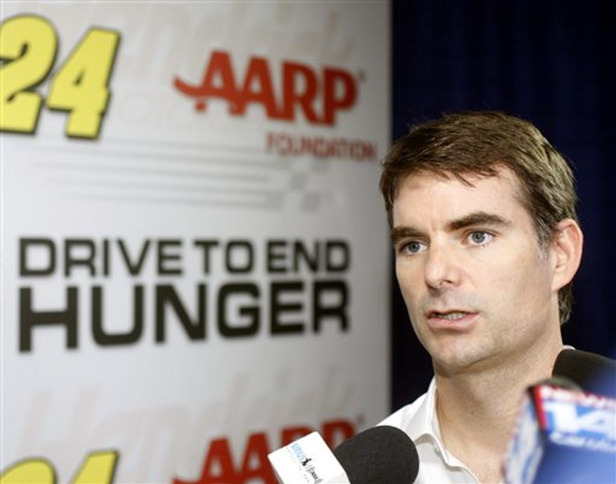 Rick Hendrick, right, owner of Hendrick Motorsports, announces the AARP and the AARP Foundation Drive to End Hunger will be the 2011 sponsor of Jeff Gordon's race car during a news conference at Hendrick Motorsports in Concord, N.C. on Wednesday, Oct. 27, 2010, as Gordon, center, and AARP Foundation president Jo Ann Jenkins.  (AP Photo/Nell Redmond)