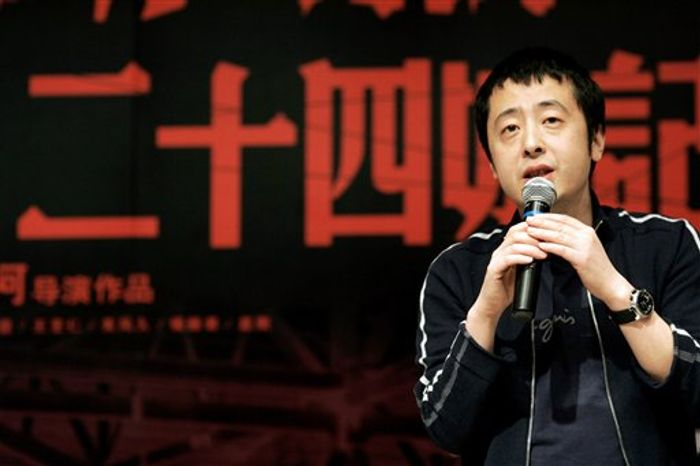 "FILE - In this March 7, 2009 file photo, Chinese film director Jia Zhangke speaks during a press conference of his new film titled ""24 City"" in Shanghai, China. The Golden Lion-winning Chinese director best known for portraying working-class struggles on Saturday, Oct. 30, 2010 defended his decision to try his hand at commercial cinema as he prepares to make his first kung fu epic. (AP Photo/File)"