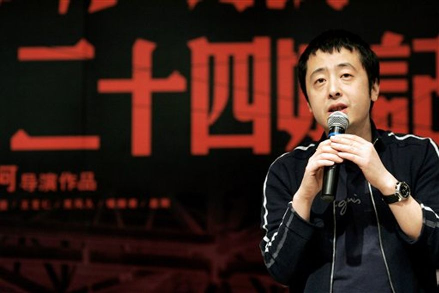 """FILE - In this March 7, 2009 file photo, Chinese film director Jia Zhangke speaks during a press conference of his new film titled """"24 City"""" in Shanghai, China. The Golden Lion-winning Chinese director best known for portraying working-class struggles on Saturday, Oct. 30, 2010 defended his decision to try his hand at commercial cinema as he prepares to make his first kung fu epic. (AP Photo/File)"""