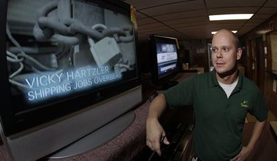 In this Oct. 27, 2010 photo, television repairman Josh Vannoy, who frequently hears complaints from customers about this year's political advertisements, stands next to a television showing a political ad at his store in Sedalia, Mo. Ads in U.S. House and Senate races have risen 50 percent; in gubernatorial races, they've more than doubled, according to figures from the Wesleyan Media Project, which analyzes ads. The political ad blitz has been an economic stimulus for broadcasters. For television viewers, however, the barrage of ads accusing politicians of being out-of-touch, corrupt liars can get overwhelmingly. (AP Photo/Charlie Riedel)