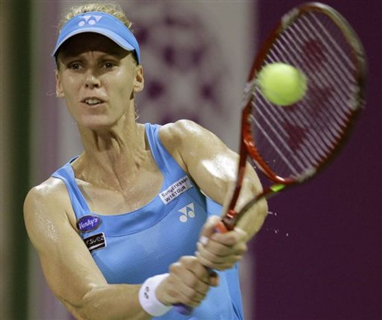 Russia's Elena Dementieva returns the ball to Italy's Francesca Schiavone during the 4th day of Qatar WTA Tennis Championship in Doha, Qatar, Friday Oct. 29, 2010. (AP Photo/Kamran Jebreili)