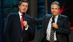 **FILE** In this photo from Oct. 2, 2010, Stephen Colbert (left) and Jon Stewart appear on stage at Comedy Central's 'Night Of Too Many Stars: An Overbooked Concert For Autism Education' at the Beacon Theatre in New York. (Associated Press)