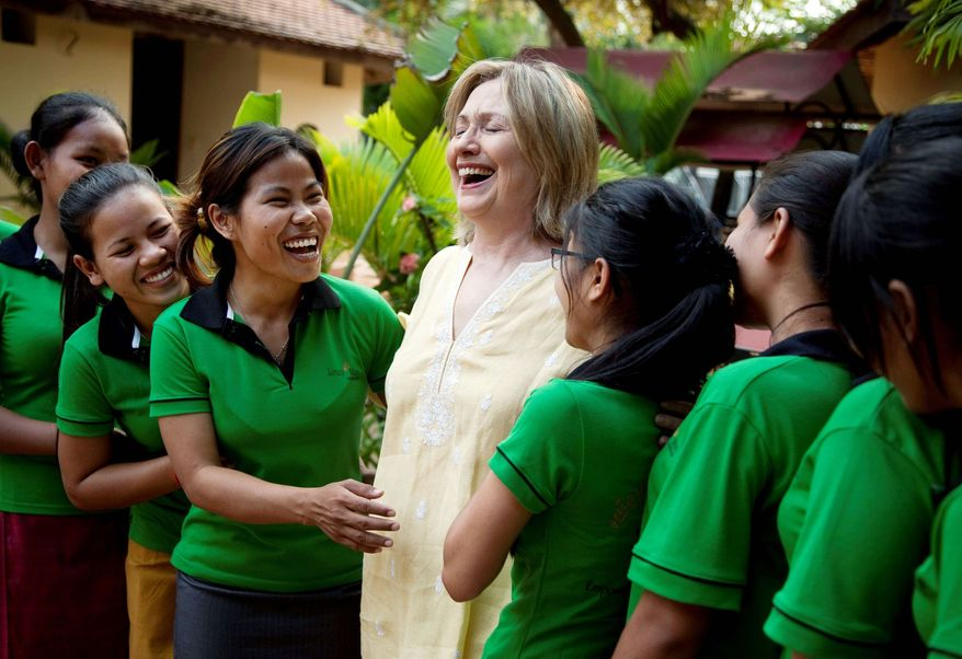 Secretary of State Hillary Rodham Clinton shares a laugh with girls from the Siem Reap Center, a U.S.-funded shelter in Siem Reap, Cambodia, that provides rehabilitation and vocational training for sex-trafficking victims. (Associated Press)