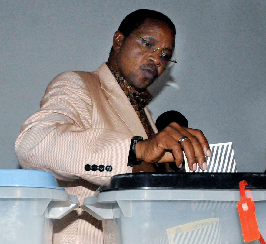 Seeking re-election, Tanzanian President Jakaya Kikwete casts his vote in his home village of Msoga, about 75 miles north of the capital, Dar es Salaam, Tanzania, on Sunday. (Associated Press)