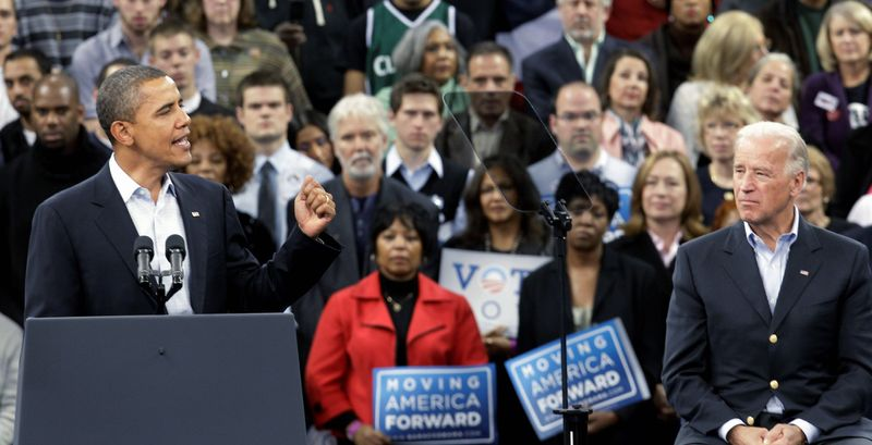 BACK AGAIN: As Vice President Joseph R. Biden Jr. (right) looks on, President Obama addresses a Sunday rally at Cleveland State University. Mr. Obama has been to the swing state of Ohio on behalf of the Democratic nominees for governor and Senate a dozen times. (Associated Press)