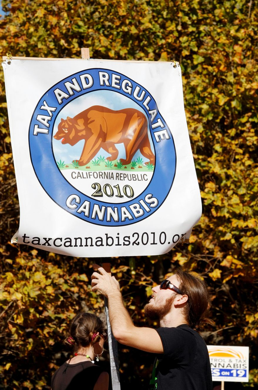 Associated Press David Mieler, a backer of Proposition 19, an initiative to legalize recreational marijuana use, attends a Monday rally at the University of California at Berkeley.