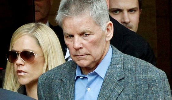 ** FILE ** Former Rep. Gary A. Condit leaves court after testifying in the Chandra Levy murder trial. He refused to answer whether the two had an affair. (Associated Press)