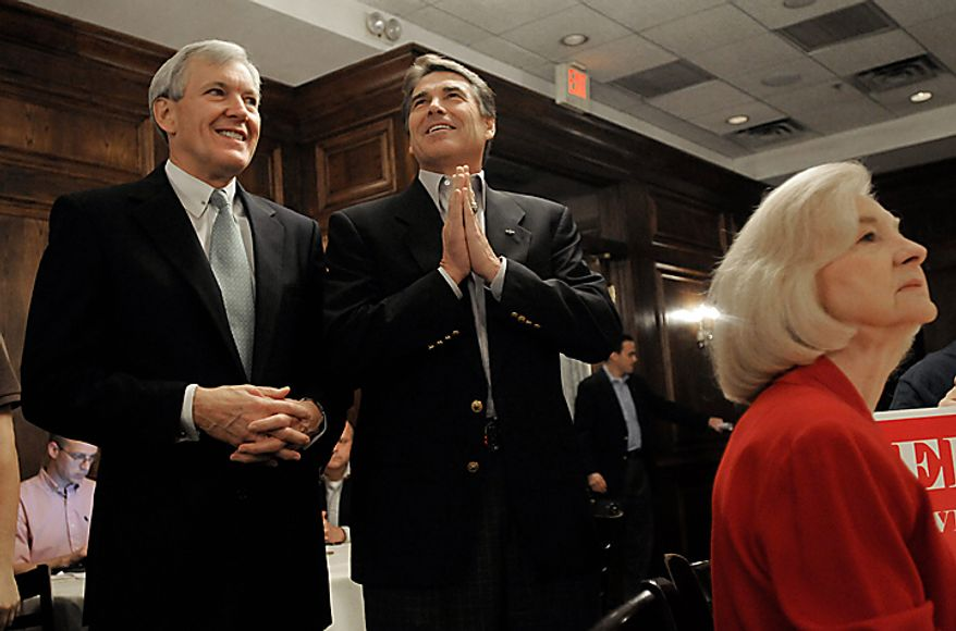 Dallas Mayor Tom Leppert, left, stands next to Texas Gov. Rick Perry as Perry waits to give a campaign speech, Monday, Nov. 1, 2010, in Dallas. (AP Photo/Rex C. Curry)