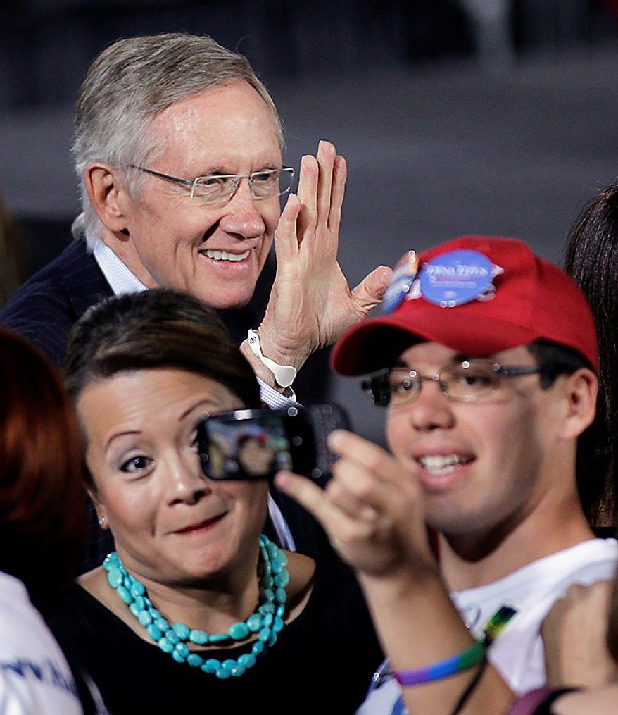 Senate Majority Leader Sen. Harry Reid of Nev. waves to supporters after a rally in Las Vegas, Monday, Nov. 1, 2010. (AP Photo/Julie Jacobson)