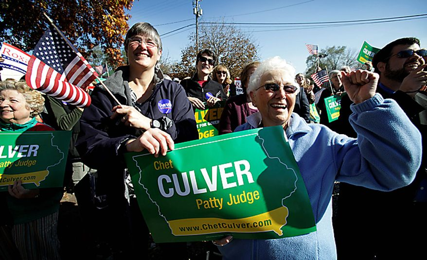 Mary Larew, left, and her mother Virginia Spalding, both of Iowa City, Iowa, listen to Iowa Gov. Chet Culver speak during a stop on his campaign train tour, Monday, Nov. 1, 2010, in Iowa City, Iowa. (AP Photo/Charlie Neibergall)