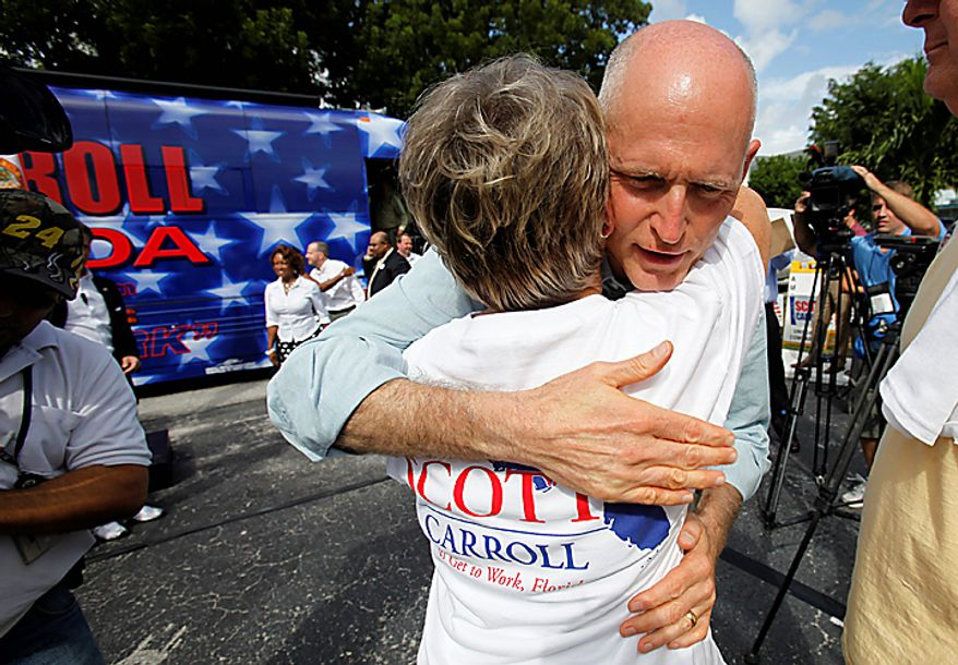 Florida Republican gubernatorial candidate Rick Scott hugs a supporter during a campaign stop at his Broward County campaign headquarters Monday, Nov. 1, 2010, in Fort Lauderdale, Fla. (AP Photo/Lynne Sladky)