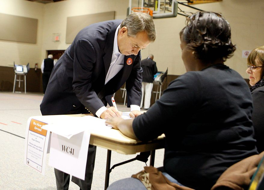 ASSOCIATED PRESS House Minority Leader John A. Boehner signs in before casting his vote on Tuesday at a polling place in West Chester, Ohio.