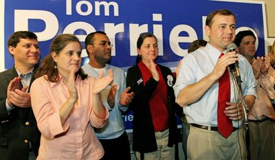 ASSOCIATED PRESS Candidate for the Virginia's 5th Congressional District, Rep. Tom Perriello, a Democrat, makes his concession speech surrounded by family Tuesday in Charlottesville. He lost to state Sen. Robert Hurt, who had about 51 percent of the vote to Mr. Perriello's 47 percent with 94 percent of precincts reporting.