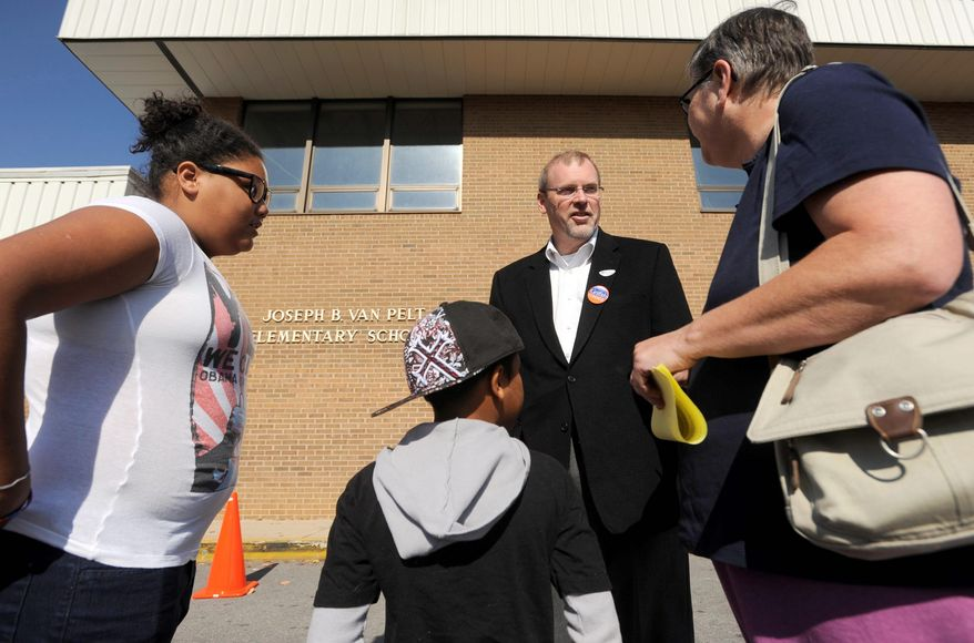 Morgan Griffith, Republican congressional candidate (center), greets a voter Tuesday morning at Van Pelt Elementary School in Bristol, Va.