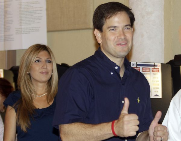 Florida Republican U.S. Senate candidate Marco Rubio gives two thumbs up after casting his vote as his wife Janette