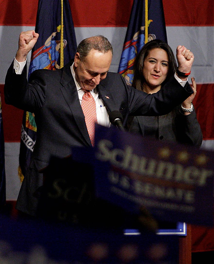 Sen. Charles Schumer, D-N.Y., gestures while speaking at a Democratic candidates party Tuesday, Nov. 2, 2010 in New York. (AP Photo/Frank Franklin II)