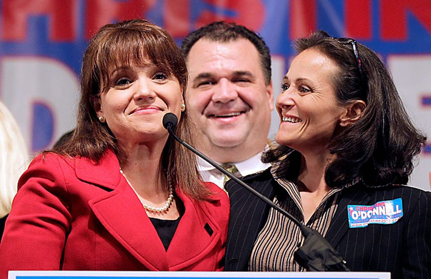 Delaware Republican Senate candidate Christine O'Donnell, left, stands with her brother Dan, center, and sister Jennie, right, after delivering remarks to supporters after conceding the election to opponent Democrat Chris Coons, Tuesday, Nov. 2, 2010, in Dover, Del. (AP Photo/Rob Carr)