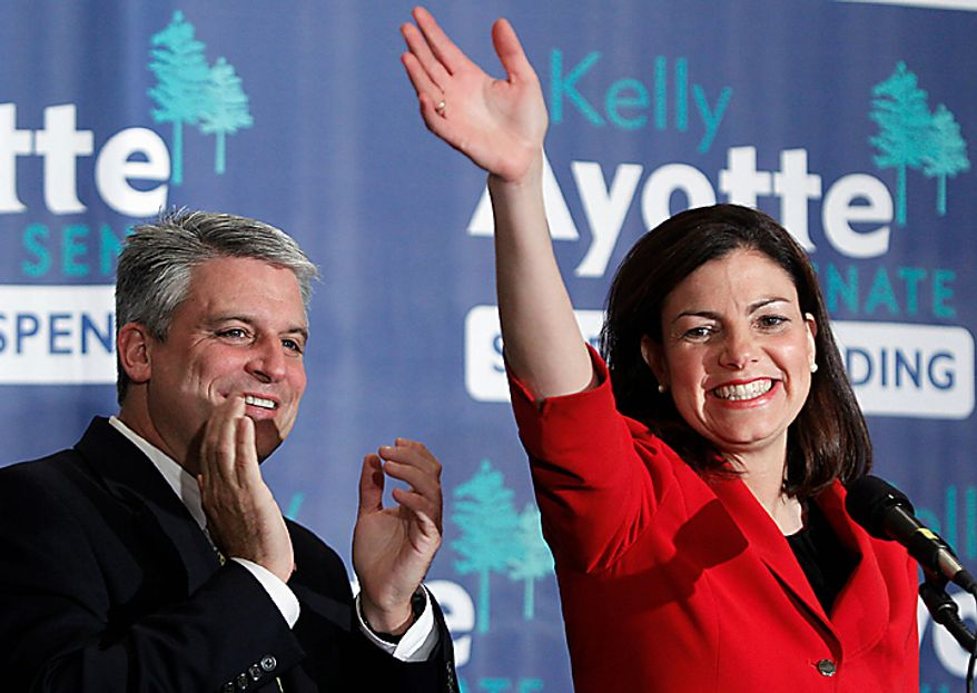 New Hampshire Sen.-elect Kelly Ayotte, with husband Joe Daley by her side, celebrates winning the Senate race in Concord, N.H., Tuesday, Nov. 2,  2010. (AP Photo/Cheryl Senter)