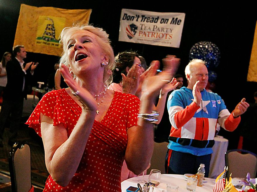 """A woman who goes by one name, """"Scout,"""" cheers a speaker as members of the Tea Party Patriots hold an election night party in Washington,  Tuesday,  Nov. 2, 2010.  (AP Photo/Ann Heisenfelt)"""