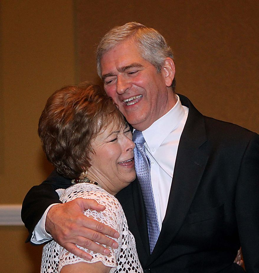 Daniel Webster gets a hug from his sister, Pam Webster Brown,  a victory party at the Rosen Shingle Creek, after learning that incumbent congressman Alan Grayson had conceded the 8th district, Tuesday Nov. 2, 2010. (AP Photo/Orlando SentinelJoe Burbank)