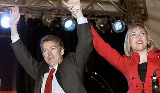 Sen.-elect Rand Paul. R-Ky., and his wife Kelley arrive at his victory celebration in Bowling Green, Ky., Tuesday, Nov. 2, 2010.  (AP Photo/Ed Reinke)