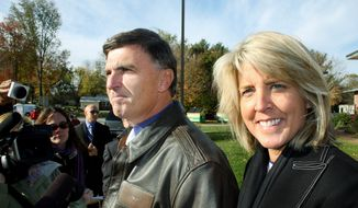 Republican former Gov. Robert L. Ehrlich Jr. talks to reporters before voting in Annapolis, Md., with his wife, Kendel Ehrlich, in this file photo. (Associated Press) ** FILE **