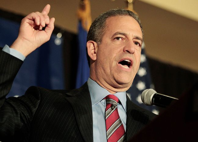 Sen. Russ Feingold, Wisconsin Democrat, makes his concession speech to supporters Tuesday night in Middleton, Wis., after losing to Republican challenger Ron Johnson. (Associated Press)