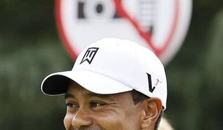 Tiger Woods of the U.S. smiles during the Pro-Am event of the Shanghai HSBC Champions golf tournament, which begins on Thursday, at the Sheshan International Golf Club in Shanghai Wednesday, Nov. 3, 2010. (AP Photo/Andy Wong)